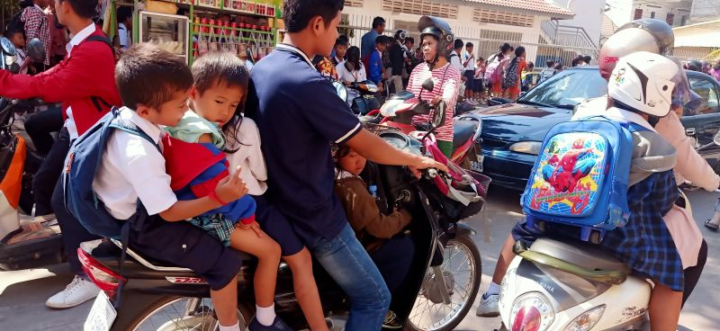 many people on a motorbike
